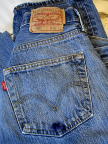 Grainy blue denim pre shrunk button front 501 Levis jeans